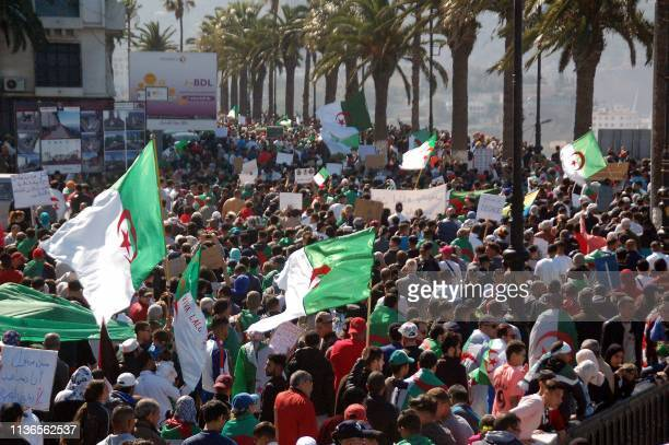 Algerians march with national flags along the waterfront during an antigovernment protest in the northern coastal city of Oran on April 12 2012...