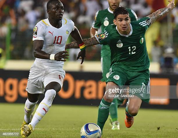 Algerian's national football team's Carl MeMedjani vies with Senegal's Sadio Mane during the 2015 African Cup of Nations group C football match...