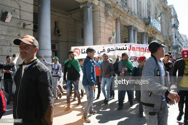 Algerians participate in a protest against their ailing president's bid for a fifth term in power in the northeastern city of Annaba on March 3 2019...