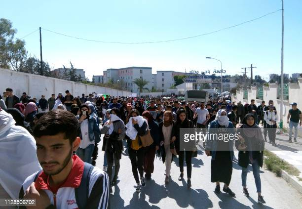Algerians participate in a protest rally against ailing President's bid for a fifth term in power outside the Badji Mokhtar University in the...