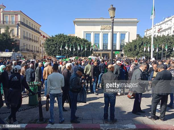 Algerians participate in a protest rally against their ailing president's bid for a fifth term in power in the northeastern city of Annaba on March 3...
