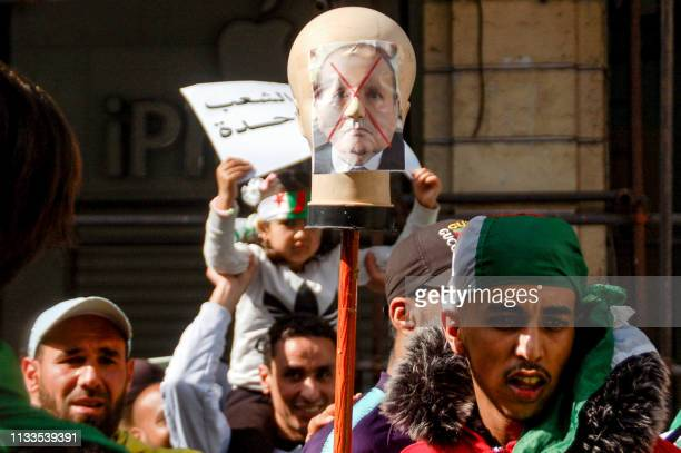 Algerians protest during a demonstration against ailing President Abdelaziz Bouteflika in the northern coastal city of Oran on March 29 2019...