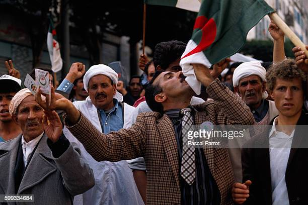 Algerians protest in Algiers protest in support of the Front de Libertaion Nationale or National Liberation Front and against the Front Islamique du...