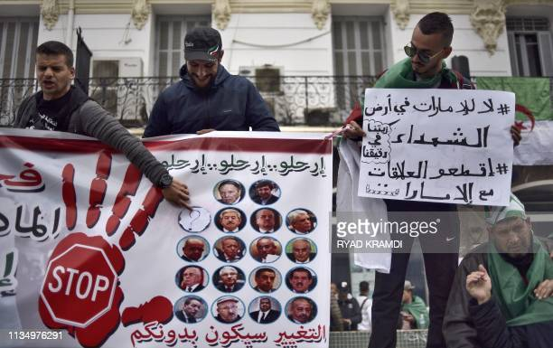 Algerians raise banners and placards as they take part in a demonstration against the current government on April 5 2019 in the capital Algiers...