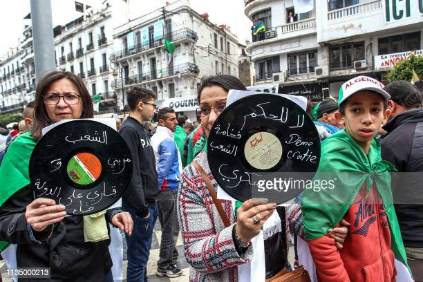 Algerians show vinyl records with slogans written on them such as No to military rule during an antigovernment demonstration in the capital Algiers...