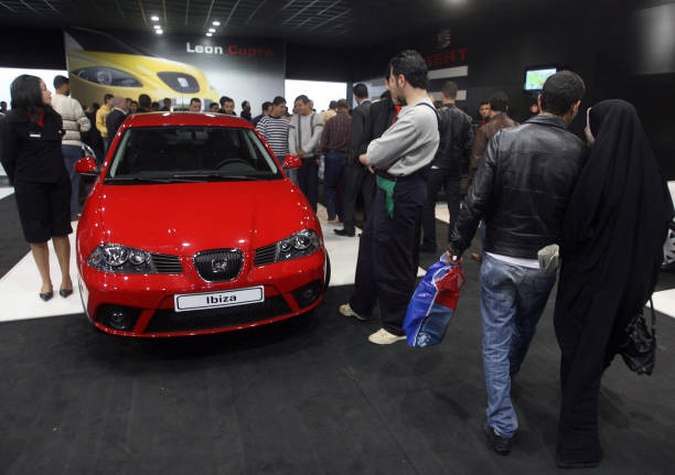 Algerians Stand By A Seat Ibiza Vehicle On Display At The - Car show wheel display stands