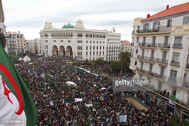 TOPSHOT Algerians take part in a demonstration against ailing President Abdelaziz Bouteflika in front of La Grande Poste in the centre of the capital...