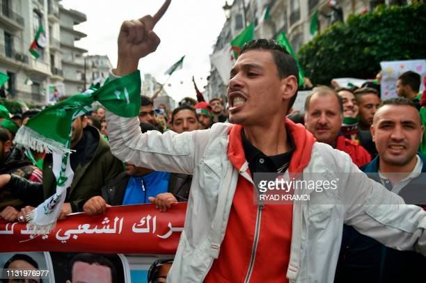 Algerians take part in a demonstration against ailing President Abdelaziz Bouteflika in the capital Algiers on March 22 2019 Bouteflika said on...