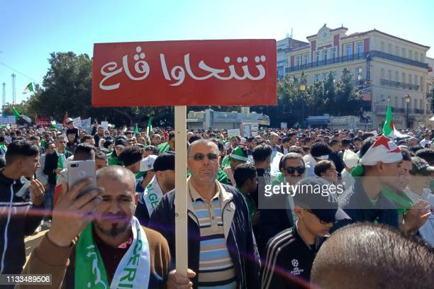 Algerians take part in a demonstration against ailing President Abdelaziz Bouteflika in the northeastern city of Annaba about 570 kilometres west of...