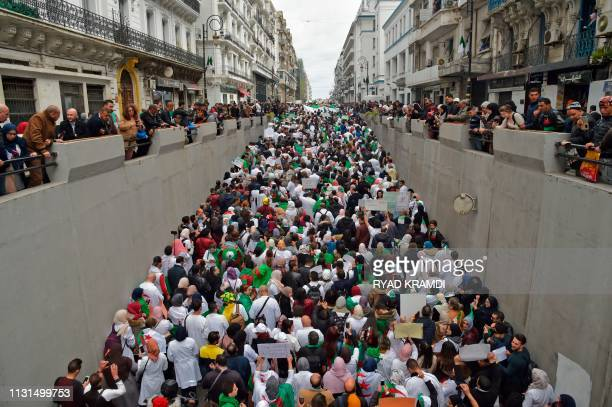 TOPSHOT Algerians take part in a demonstration in the capital Algiers against President Abdelaziz Bouteflika on March 19 2019 Bouteflika today...