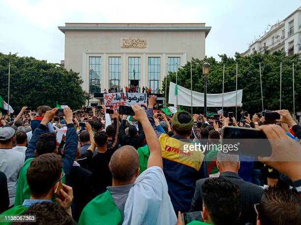 Algerians take part in a demonstration on April 19 in the northeastern city of Annaba about 570 kilometres west of the capital Algiers and about 100...