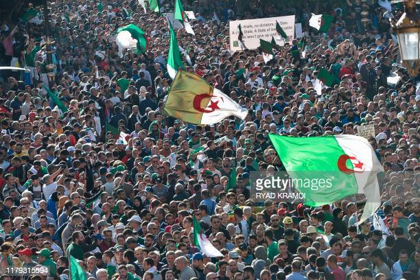 Algerians take part in an anti-government demonstration in the capital Algiers on November 1, 2019. - Demonstrators converged on Algiers in their...