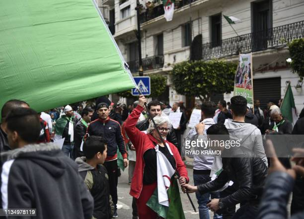 Algerians take part in an antigovernment demonstration on April 5 2019 in the capital Algiers Algerians were gathered today for the first mass...