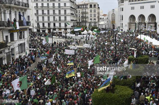 TOPSHOT Algerians take part in an antigovernment demonstration on April 5 2019 in the capital Algiers Algerians were gathered today for the first...