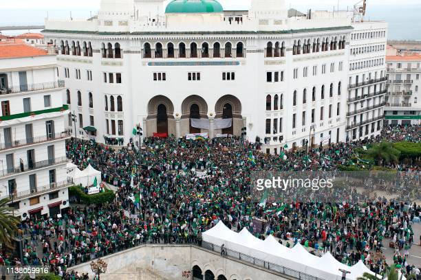 Algerians waving national flags and banners shout slogans in front of La Grande Poste during an anti government demonstration in the capital Algiers...