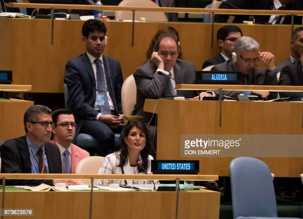 Algeria's Ambassador to the United Nation listen as US Ambassador Nikki Haley speak during voting to condemn Israeli actions in Gaza in the General...
