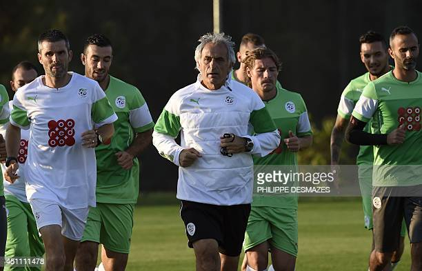 Algeria's Bosnian coach Vahid Halilhodzic runs with his players during a training session at The Atletico World Sports Centre in Sorocaba on June 23...