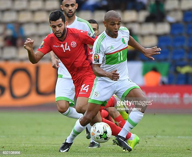 Algeria's Brahimi in action against Tunisia's Mohamed Amine Ben Amor during the African Cup of Nations Group B soccer match between Algeria and...