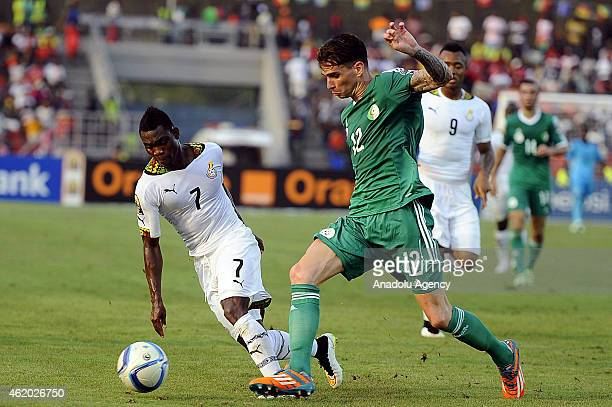 Algeria's Carl Medjani vies for ball with Ghana's Christian Atsu during the 2015 African Cup of Nations Group C football match between Ghana and...