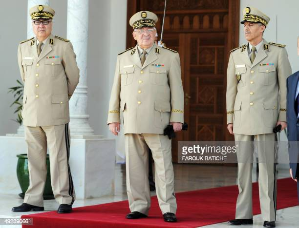 Algeria's Chief of Staff General Ahmed Gaid Salah is seen during the arrival of French Defence Minister JeanYves Le Le Drian at the HouariBoumediene...