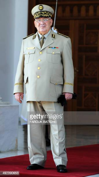 Algeria's Chief of Staff General Ahmed Gaid Salah is seen for the arrival of French Defence Minister JeanYves Le Le Drian at the HouariBoumediene...