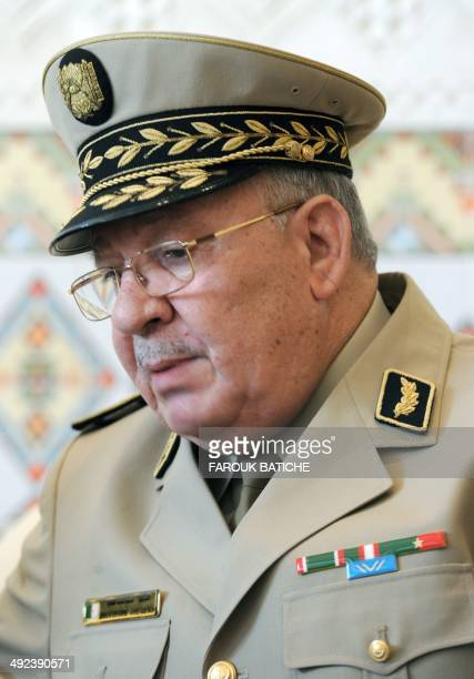 Algeria's Chief of Staff General Ahmed Gaid Salah speaks with French Defence Minister JeanYves Le Le Drian upon his arrival at the HouariBoumediene...