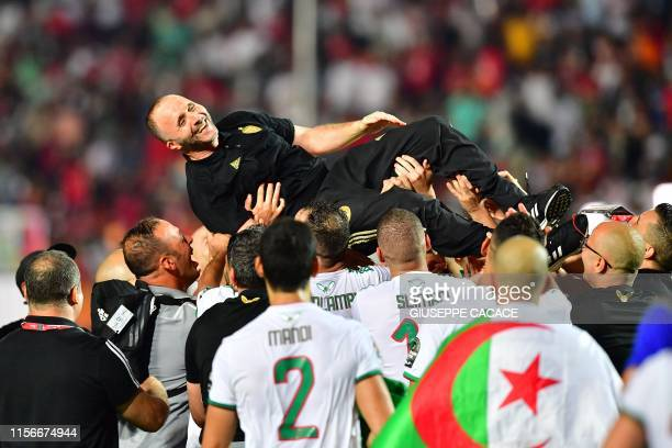 Algeria's coach Djamel Belmadi celebrates after winning the 2019 Africa Cup of Nations Final football match between Senegal and Algeria at the Cairo...