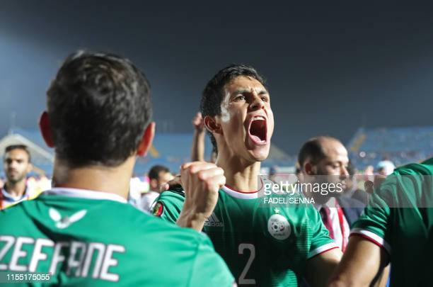 TOPSHOT Algeria's defender Aissa Mandi celebrates after winning the 2019 Africa Cup of Nations quarter final football match between Ivory Coast and...