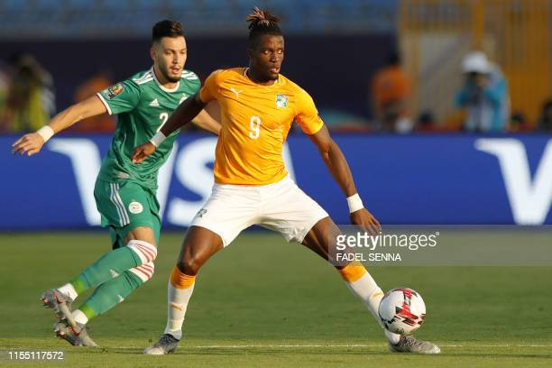 Algeria's defender Aissa Mandi fights for the ball with Ivory Coast's forward Wilfried Zaha during the 2019 Africa Cup of Nations quarter final...