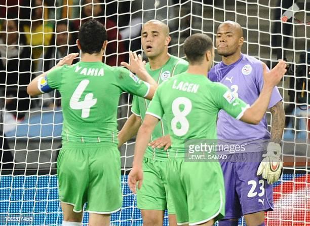 Algeria's defender Anther Yahia Algeria's defender Madjid Bougherra Algeria's midfielder Mehdi Lacen and Algeria's goalkeeper M'bohi Rais Oulheb...