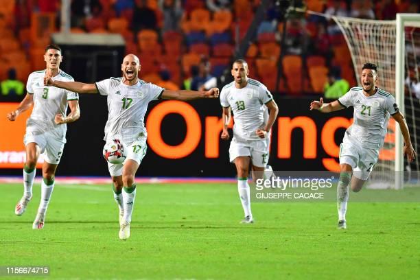 Algeria's defender Mehdi Tahrat Algeria's midfielder Adlene Guedioura Algeria's forward Islam Slimani Algeria's defender Ramy Bensebaini celebrate...