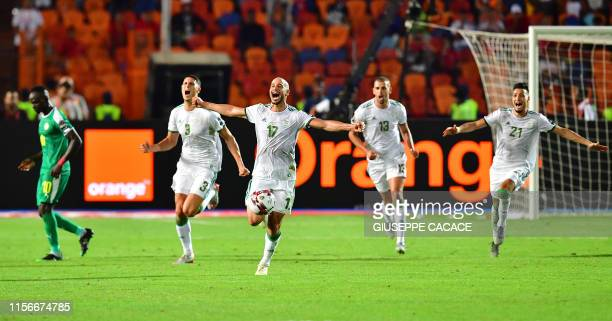 TOPSHOT Algeria's defender Mehdi Tahrat Algeria's midfielder Adlene Guedioura Algeria's forward Islam Slimani Algeria's defender Ramy Bensebaini...