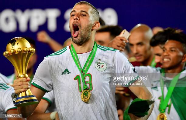 Algeria's defender Mehdi Zeffane celebrates after winning the 2019 Africa Cup of Nations Final football match between Senegal and Algeria at the...