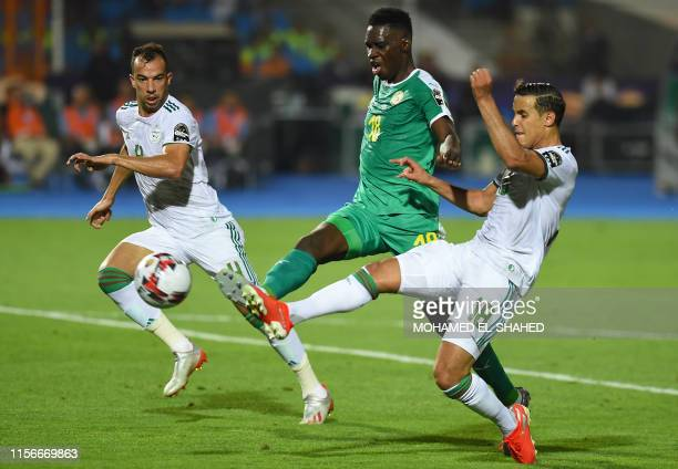 Algeria's defender Mehdi Zeffane fights for the ball with Senegal's forward Ismaila Sarr during the 2019 Africa Cup of Nations Final football match...