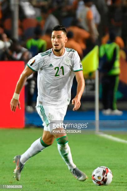 Algeria's defender Ramy Bensebaini runs with the ball during the 2019 Africa Cup of Nations Final football match between Senegal and Algeria at the...