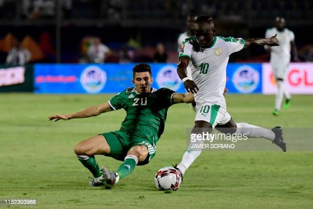 Algeria's defender Youcef Atal marks Senegal's forward Sadio Mane during the 2019 Africa Cup of Nations football match between Senegal and Algeria at...