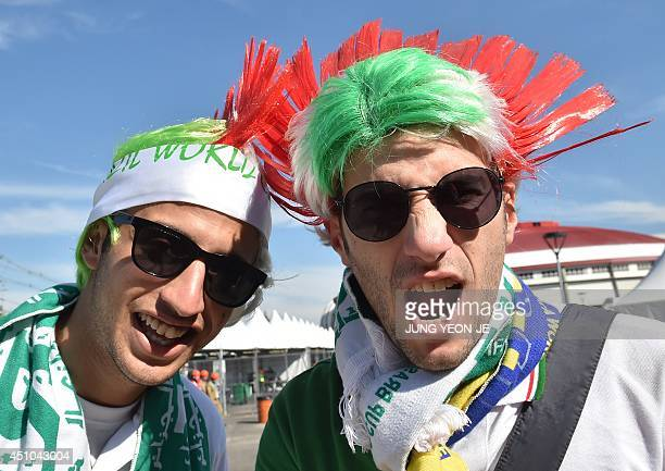 Algeria's fans are pictured outside the stadium before the start of a Group H match between South Korea and Algeria at the BeiraRio Stadium in Porto...