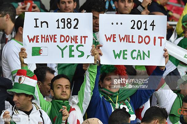 Algeria's fans cheer during the Round of 16 football match between Germany and Algeria at BeiraRio Stadium in Porto Alegre during the 2014 FIFA World...