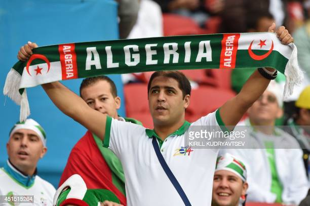 Algeria's fans cheer prior to the Round of 16 football match between Germany and Algeria at BeiraRio Stadium in Porto Alegre during the 2014 FIFA...
