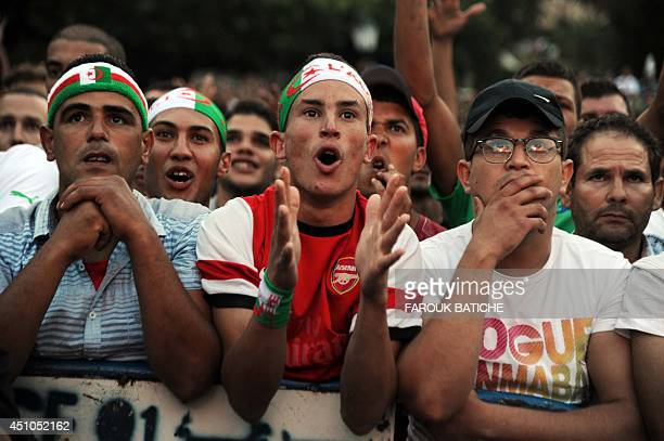 Algeria's fans react as they watch the FIFA 2014 World Cup football match Algeria vs South Korea on a big screen in central Algiers on June 22 2014...