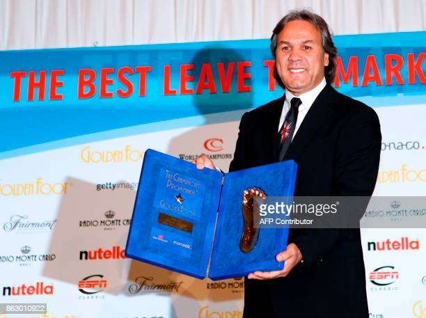 Algeria's former football player Mustapha Rabah Madjer poses with an award on October 10 2011 in Monaco during the 2011 Golden Foot Award The Golden...