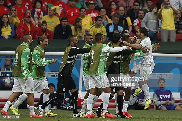 Algeria's forward Abdelmoumene Djabou celebrates with teammates after scoring his team's third goal during the Group H football match between South...