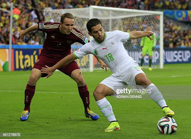 Algeria's forward Adbdelmoumene Djabou and Russia's defender Aleksei Kozlov vie for the ball during a Group H football match between Algeria and...