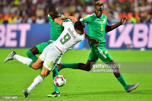 Algeria's forward Baghdad Bounedjah fights for the ball during the 2019 Africa Cup of Nations Final football match between Senegal and Algeria at the...