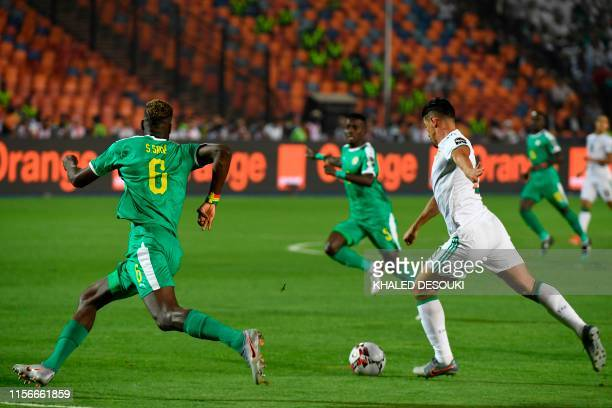 Algeria's forward Baghdad Bounedjah shoots to score during the 2019 Africa Cup of Nations Final football match between Senegal and Algeria at the...