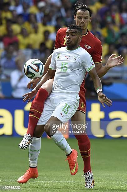 Algeria's forward El Arabi Soudani is challenged by Belgium's defender Daniel Van Buyten during the Group H football match between Belgium and...