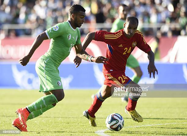 Algeria's forward Hilal Soudani El Arabi vies for the ball with Armenian defender Alex Da Silva during the friendly football match between Algeria...