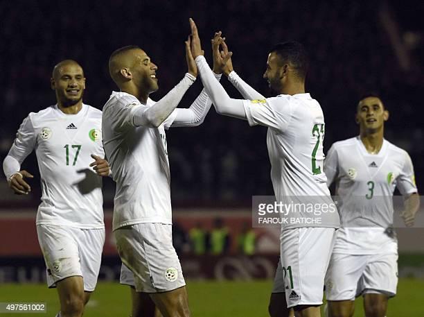 Algeria's forward Islam Slimani celebrates with teammates forward Rachid Ghezzal and midfielder Adlène Guedioura during the FIFA World Cup 2018...