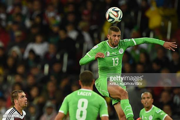 Algeria's forward Islam Slimani heads the ball during a Round of 16 football match between Germany and Algeria at BeiraRio Stadium in Porto Alegre...