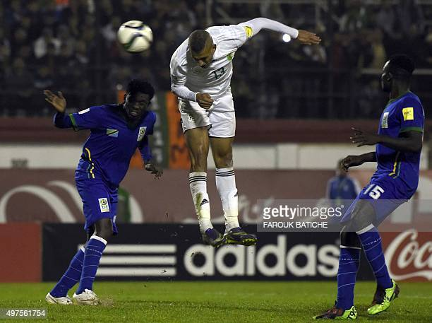 Algeria's forward Islam Slimani heads the ball during the FIFA World Cup 2018 qualifying football match between Algeria and Tanzania on November 17...